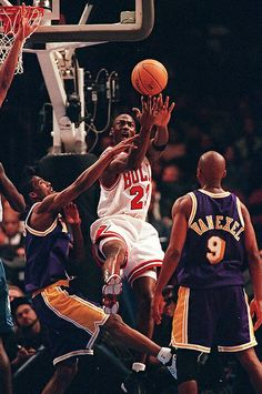 The GOAT avoids the pressure by Eddie Jones and Nick Van Exel for the shot attempt in New York.