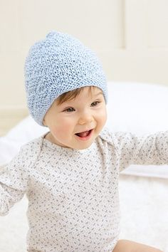 Happy blue baby hat made with the Knook™. Buy this in a book bundle: http://www.leisurearts.com/sale/bundles/knook-baby-value-pa…