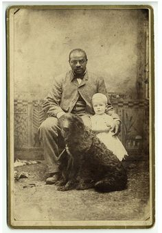 Vintage photograph of man with child and dog by Barke, 1890, via Dog Art Today.