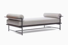Daybreak Daybed contemporary high end patio furniture in teak and polished stainless steel with finish options. Outdoor fabric choices to the trade.