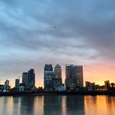 Another day Another sunset.. Canary wharf again! #london #city #uk #england #summer #capital #skyscraper #bank #canarywharf #financialdistrict #thames #riverthames #gopro #hero #hero4 #beahero #sunset #sun #horizon #motorbike #ride #evening #potd #photography #reflection #water #river by scottk_25