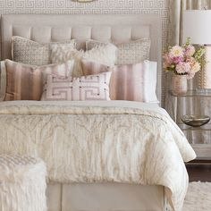 Poised yet playful, the Halo Bedding Collection adds a touch of romance to any space. Its shiny velvet textures, metallic woven patterns and faux fur  embellishments create an air of effortless extravagance in a pristine color palette.   From Eastern Accents  .       Front: 40% polyester, 30% linen, 15% polyacrylic, 15% viscose  .       Back: 100% polyester  .       Two layers of decorative fabric with polyester batting secured inside  .       Button-Tufted style is tufted with buttons on the fa