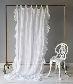 excellent idea.  hang white fabric as backdrop, smallish sigh, and hoops with favorite fabrics?