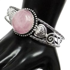 """Iba Silver Tone Rose Quartz Stone Adjustable Cuff Bracelet Fashion Bollywood Party Wear Jewelry IBA. $15.99. Silver Tone Cuff. SALE FOR - 1 Cuff Bracelet; MATERIAL - Alloy;. SIZE - Width from top 0.9""""inches(Adjustable), Stone length:1.1"""" x 1.1""""; COLOR - Silver Tone;"""