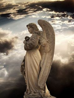 A lovely angel against the night sky