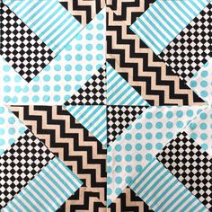 Have some fun with color and shapes in your quilting with the Doubly Striped Half Square Triangle Block. Even though this quilt block may seem complicated at first glance, it's not difficult or time consuming to make.