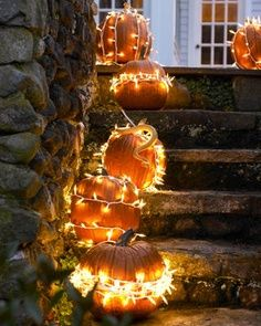 Just wrap lights around the pumpkins...awesome