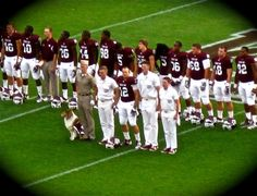 Aggie football players, yell leaders, & Miss Rev :)