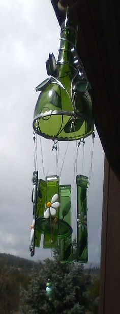 Create this easy wind chime using an old wine bottle. To create this you need to first cut the bottle using a cutter and soften the edges. Poke small holes right above the edge of the bottle to hang chimes. Using a thin wire you can hang metal chimes or you can make your own using the leftover from the wine bottle by cutting it in small thin pieces. Again, make sure to soften the edges, you don't want anyone hurt. You can decorate the bottle using paint or stick other decorative item on it.