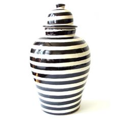 The black striped tibor is a great example -- it adds a modern, yet authentic touch to the home, whether displayed prominently on the shelf, used to decorate the patio, or when the lid is removed, filled with a large bouquet of fresh flowers | domino.com
