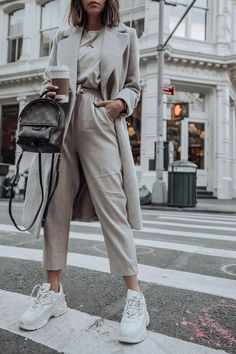 White dad sneakers with Palm Springs mini backpack monochrom outfit. Streetstyle outfit with chic details and neutral colors. #womans #fashion #Chicoutfit #Winterstyle Get more outfit & style tips at www.HerFashionedLife.com