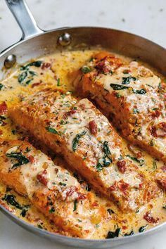 Salmon recipes 28288303898928073 - Creamy Garlic Tuscan Salmon With Spinach and Sun-Dried Tomatoes – – Smothered in a luscious garlic butter spinach and sun-dried tomato cream sauce, this Tuscan salmon recipe is so easy, quick, and simple. Salmon Dishes, Fish Dishes, Seafood Dishes, Taco Side Dishes, Main Dishes, Tuscan Salmon Recipe, Salmon Recipe Gourmet, Fish Recipes, Healthy Recipes