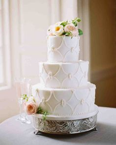Spring Wedding Cakes That Are (Almost) Too Pretty to Eat | Martha Stewart Weddings - Irby and Adam's three-tier cake by Buttercream was piped in an elegant pattern and boasted layers of pineapple, strawberry, and chocolate.
