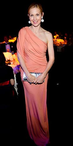 very Upper East Side-esque one-shoulder peach gown, statement earrings and metallic clutch.