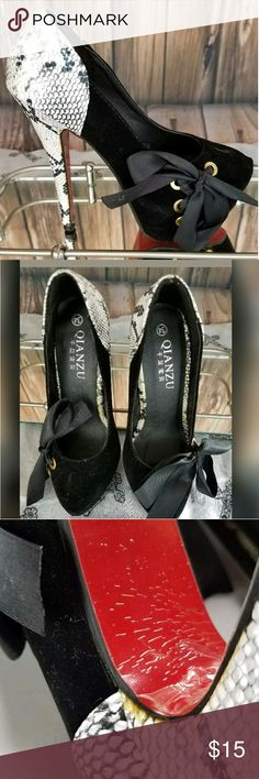 """European Stilettos Black Velvet Size 4.5 (small ) Qianzu European Stilettos  New without box plastic still attached to bottom  Eur. size 34  US size 4.5 (very small) possibly fit a younger girls foot  Snakeskin print on heel  Soft velvet on front  Nice lace up ribbon detail on front  Heel is about 5.5""""  Red Bottom  There is yellowing on different areas of the shoe. They have never been worn because they are much to small for me. I'm thinking the yellowing is something from the factory. It is…"""