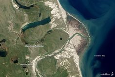 Taking a shortcut to the sea! Canada's Horton River ends in a sprawling delta along the coast of a bay, but it once had a more meandering course, as seen in abandoned channels in this image taken by NASA's Earth Observatory-1 satellite on July 31, 2012.