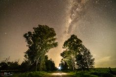 """https://flic.kr/p/LBe5NU   The Dark Road   Near Parkes, mid western NSW, Australia, about 5 hours from Sydney, near the CSIRO radio-observatory about 15 minutes from Parkes, on a dark road about 5 minutes from """"The Dish"""". The sky is bright, but the road is dark. The sudden stab of light shows the way... Sony A7rii. Samyang 14mm f/2.8. HVL F60M. ISO1600 f/4.0 30sec. Capture One raw processing. Adobe CC Ps for further noise reduction, curves, levels, and vibrance adjustments.        ..."""