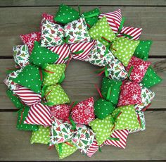 upcycling christmas door wreaths old clothes upcycling colourful rags ribbons Christmas Decorations For Kids, Christmas Door Wreaths, Christmas Crafts Sewing, Christmas Fabric, Fabric Wreath, Xmas Ornaments, Quilted Ornaments, Frame Wreath, Wreath Crafts