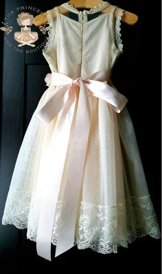 CLASSIC COLLECTION - PRODUCTION TIME - 3-4 weeks This tea length dress is to cute for words. Fully lined with a champagne lace fabric blend and has a overlay of beautiful soft bridal lace. This dress can be ordered with a matching sash and matching headpiece, adorned with a