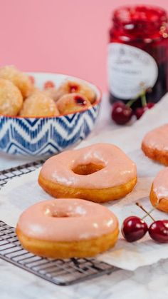 Make both classic ring doughnuts with a refreshing cherry lemonade glaze along with mini doughnut holes filled with cherry jam and coated in lemon sugar.