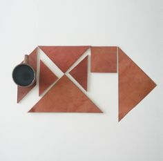 Tangram leather coasters. Bring some #origami to the table.