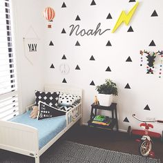 adorable kids' room with geometric decals / Get started on liberating your interior design at Decoraid (decoraid.com)
