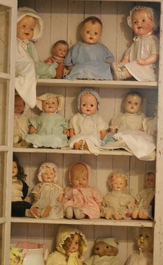 "Cabinet full of dolls. ""Repinned by Keva xo""."