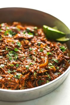 Cuban Shredded Beef (Slow Cooker) - The easiest recipe for ropa vieja! Made in the slow cooker. Just add everything in and out comes the most tender, shredded beef EVER! #cubanshreddedbeef #shreddedbeeftacos #ropavieja #slowcooker | Littlespicejar.com