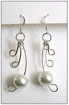 In the world of wire art jewelry, pearls always add a touch of grace. For just the perfect way to combine the two in harmony, try out some Wire Winged Pearl Earrings. Three draping wire curls unfold into a lovely opalescent pearl to make you look like you just stepped off of cloud nine.