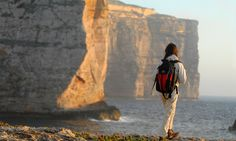 A rambler looks at the gigantic cliffs