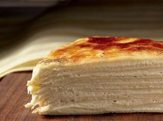 According to Keller, this is the easiest recipe in the Bouchon Bakery Cookbook. It's also one of the most fun. Toasty vanilla crêpes sandwich layer upon layer of thick, orange-zested pastry cream.