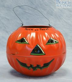 Metal Litho Halloween Jack O lantern candy container.  US Metal Toy Mfg, 1950's
