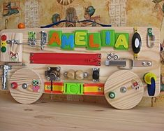 Items similar to Busy Board BUS with Felt Letters(with the child's name or with the numbers 1 to ,Sensory Montessori Toy,Wooden Toy, Toddler quiet game on Etsy Travel Toys For Toddlers, Busy Boards For Toddlers, Games For Kids, Toddler Activity Board, Activity Toys, Sensory Games, Montessori Practical Life, Childrens Room Decor, Montessori Toys
