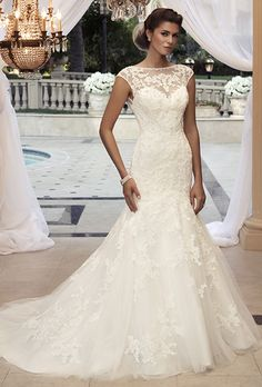 Casablanca Bridal. Beaded lace appliqu�s sewn on tulle over Silky Satin. The bateau front neckline is built up with cap sleeves for sheer coverage. The sheer beaded lace continues to a low %u201CV%u201D tank back.