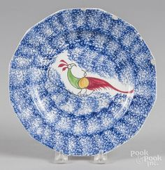 Blue spatter plate with peafowl decoration, 8 3/8'' dia. - Price Estimate: $60 - $90
