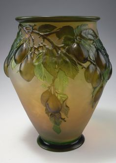 Emile Gallé, Nancy. 'Prunes' soufflé vase, 1920-25. H. 32.9 cm. Cased glass, amber, clear and green. Soufflé technique. Multiply etched pattern with plum branches at sunset. Signed: Gallé.  |  SOLD 14,000 EUR, 2015