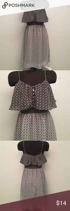 Pattern Dress Fully lined. Super cute. Button detail on front. Elastic band right below the top. Adjustable straps. 100% Polyester.   (DR) Xhilaration Dresses
