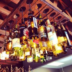 Chandelier made out of wine bottles. Awesome idea!!