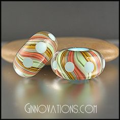 Italian Moretti glass lamp work beads by Ginnovations.These are sold but she does custom work. I adore her work!