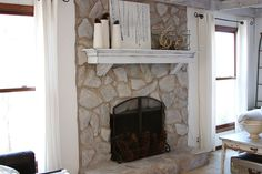 Here's a great way to update the horrid starter home fireplace. It looks like this one was cleaned and then etched to lighten the color. A rustic mantel turns this from Scary to Shabby Chic. And it was probably way less expensive than tearing it out a Whitewash Stone Fireplace, Stone Fireplace Makeover, Fireplace Update, Paint Fireplace, Home Fireplace, Fireplace Remodel, Fireplace Design, Fireplace Ideas, Annie Sloan Chalk Paint Stone Fireplace