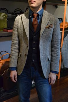 Smart look.  Denim shirt and jeans with vest and tweed blazer.