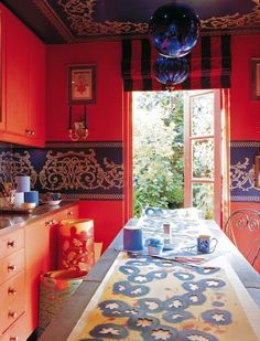 Great color choice of complimentary orange and blue keeps our eyes captivated by this image. An Indian Summer: Elle Decor India - Collectors Copy