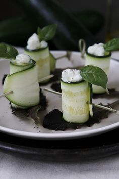 Zucchini Rolls: Slice zucchini very thin using a mandolin, then stuff with ricotta and herbs.