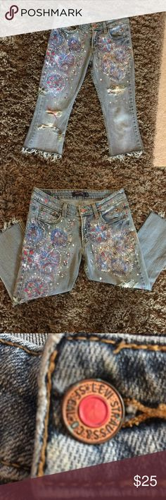 Fireworks Cropped Levi's Jeans Fireworks cropped jeans!  Perfect for July! These are hand-painted and hand-destroyed, cropped Levi's and are ready to be taken home. They have red white and blue paint a little bit of bleaching a little bit of ripping, etc. Levi's Jeans Ankle & Cropped