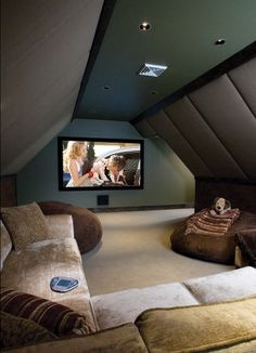 An attic turned into a home theater room! I love this, it looks like a cozy living room  but its a home theater :)