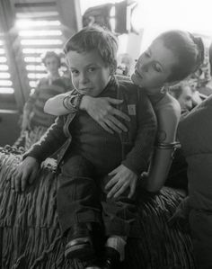 Carrie Fisher with a 12-year-old Warwick Davis on the set of Return of the Jedi, 1982.