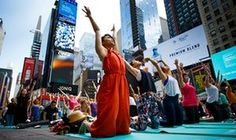 New York, USA People take part in the 15th annual Times Square yoga event Photograph: Justin Lane/EPA