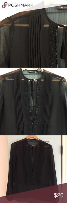 "*Host Pick* New York & Co sheer black tunic shirt New York and Co sheer black tunic shirt size 4. EUC. Ties at collar with deep v neck. Beautiful beading along the front with pleated front placket. Buttons on sleeve closure. Smoke free & pet free home. Offers considered🎉 check out my closet for additional items to bundle! LENGTH shoulder to bottom hem 25"". New York & Company Tops"