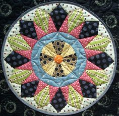 Love this with yellows for a KS sunflower. oQuilt Inspiration: PatchworkFun: patterns for serious quilters!