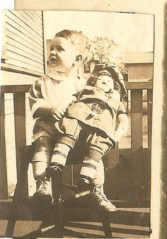 Boy with doll 1920's
